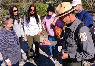 St Phillips Coastal Region Interpreter Terry Conway Explains Native American Artifacts Found on the Beach