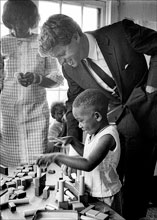 past Robert Kennedy with young school child 1967. Photo by Jim Lucas