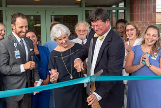collins Collins cuts the ribbon